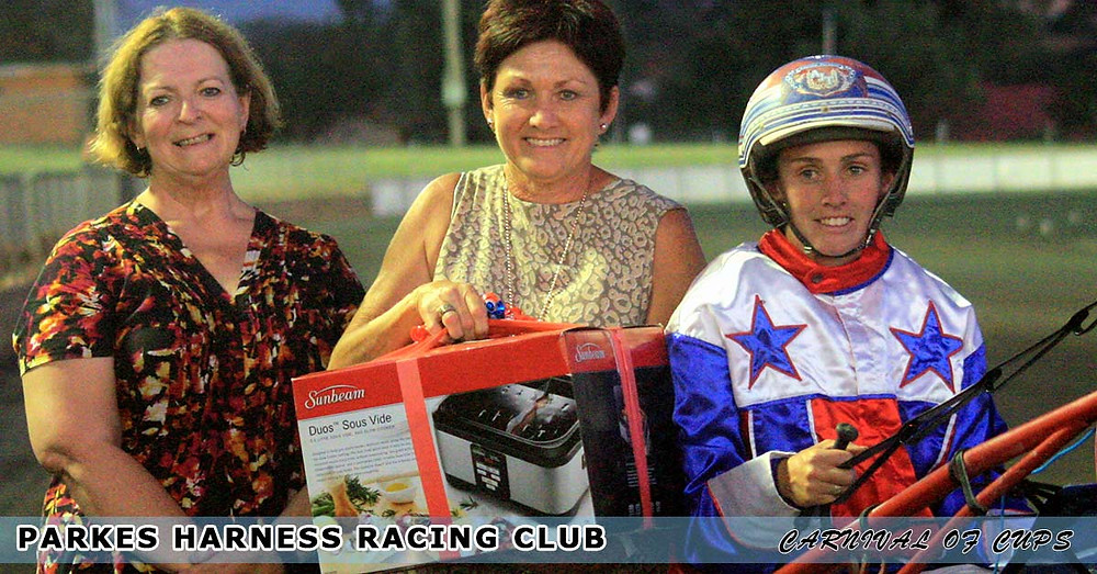 "Parkes Harness Racing Club Race 6 ""Parkes Leagues Club"". Ingrid Stephenson, Jenny Turnbull, and Amanda Turnbull."