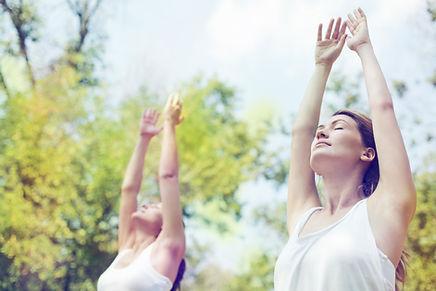 Two beautiful young women doing yoga cla