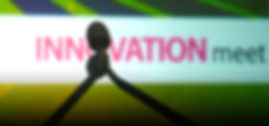 "GLOBAL EVENTS image of microphone on stage with the word at the background saying ""innovation""."