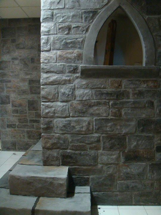 Un mur de pierre en plâtre - Yan Pigeon