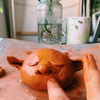 Making sure to add extra clay in the cheeks so they are extra plump