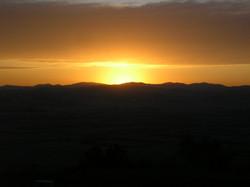 Sunset over hills near the school