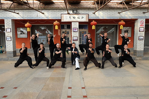 Students posing with Wang Sifu in the main training hall
