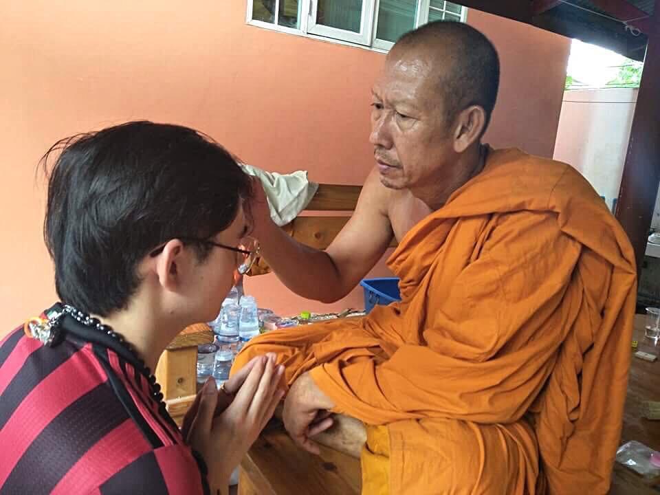 Kru Tham giving blessings