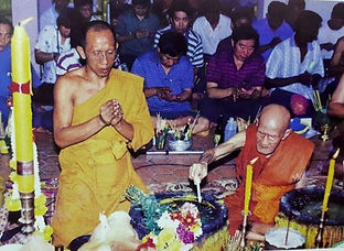 Luang Pu Wan making holy water in one of the mass chanting ceremony