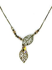 brass open leaf golden shadow swarovski