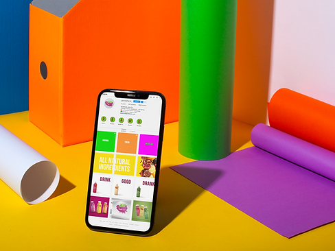 black-iphone-x-mockup-on-a-surface-with-colorful-things-a19723.png