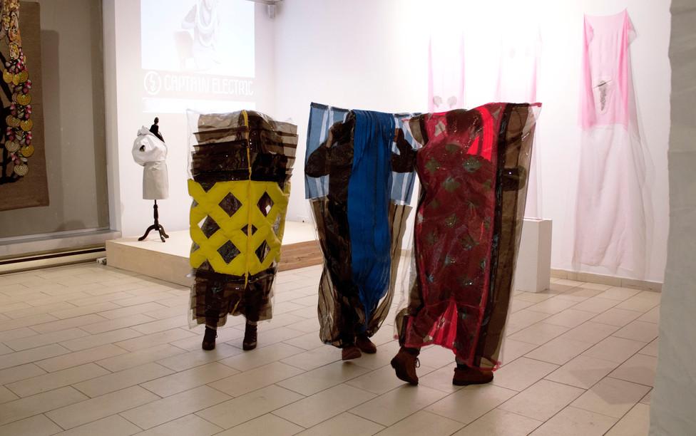 Viewers activating the sculptures at gallery Espacio Mexico