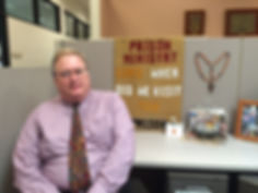 Peter Andre sitting in office.jpg