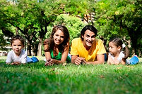 Young family lying on the grass