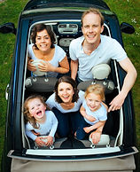 Young happy family inside a vehicle