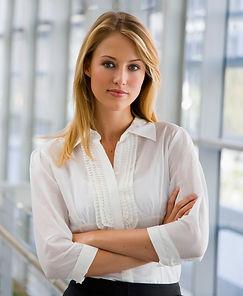 Business woman crossing arms near window