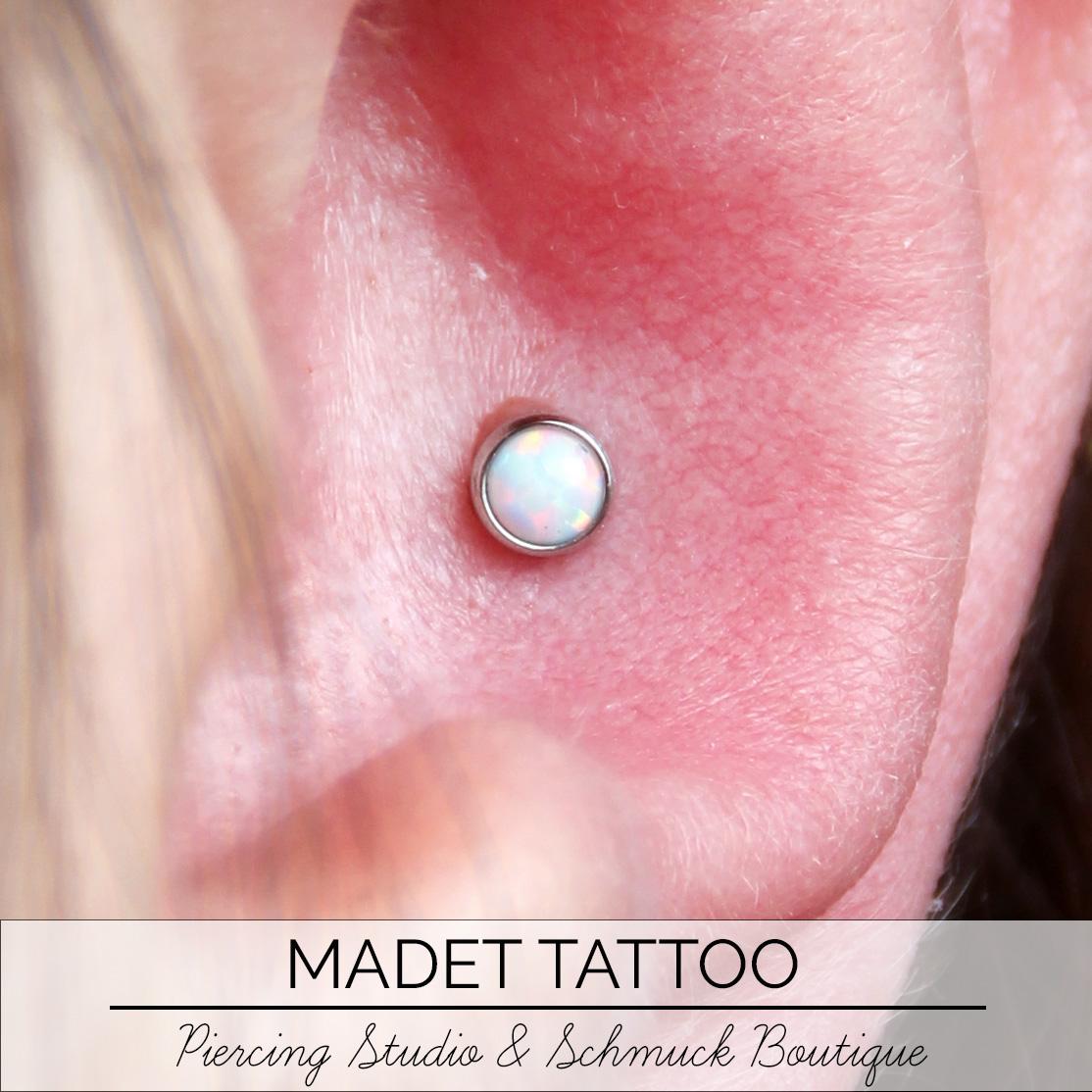 Conch Opal Piercing