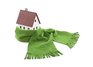 House wrapped in a scarf isolated on whi