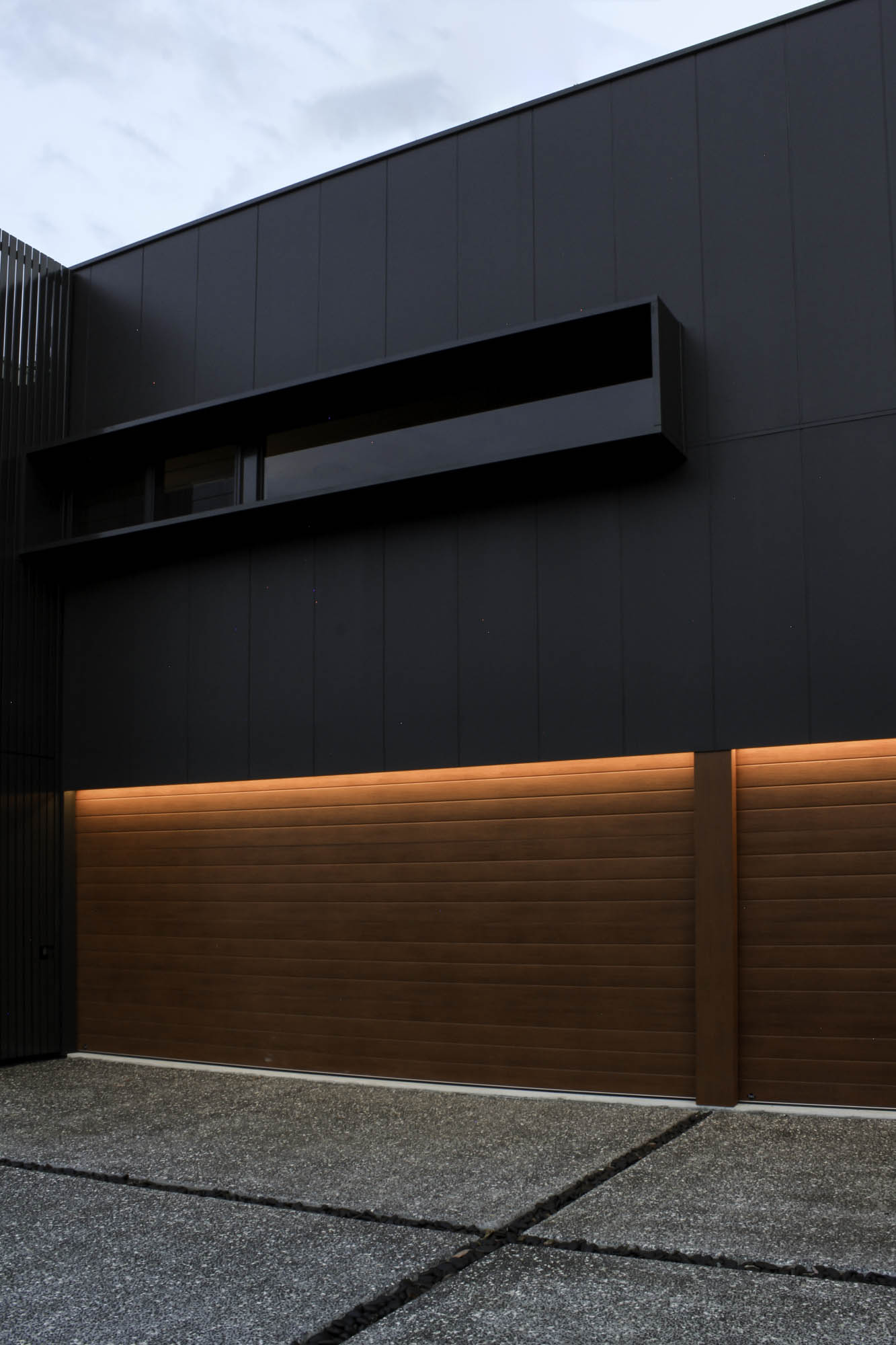 Dark Cladding + Warm Timber