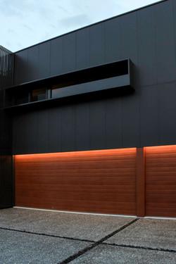 Dark Cladding + Warm Timber
