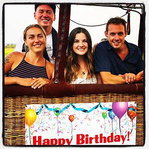 Happy birthday hot air balloon ride passengers