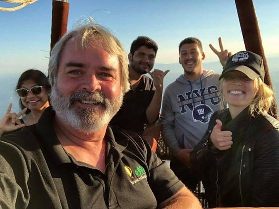 Balloon ride tour group over White river near Seattle