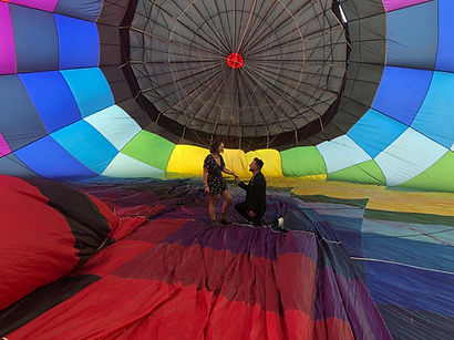 Proposal inside a colorfull hot air balloon ride.