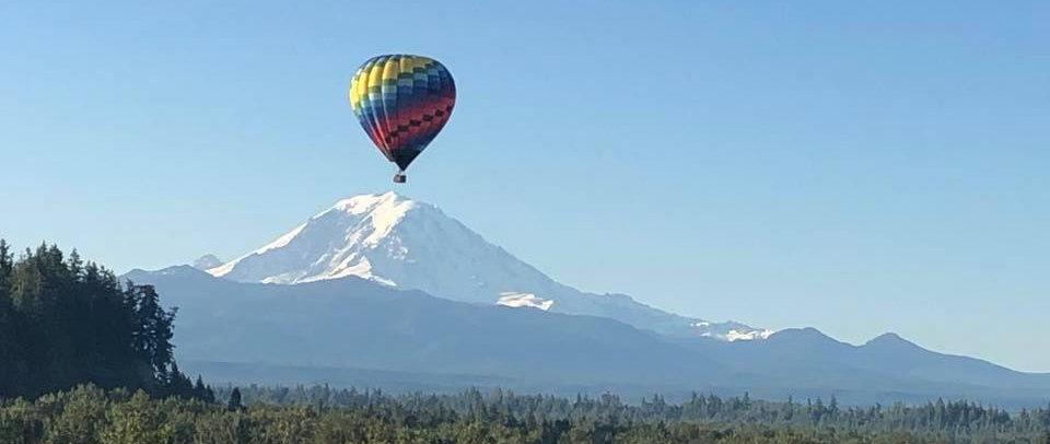 Hot air balloon in front of Mt Rainier