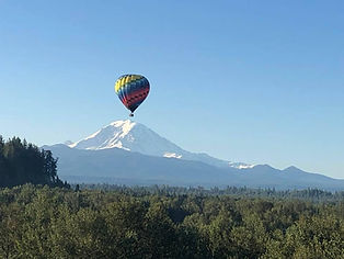 Hot air balloon ride in front of Mt Rainier and White River