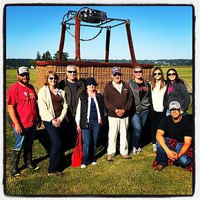 Post hot air balloon ride passengers group