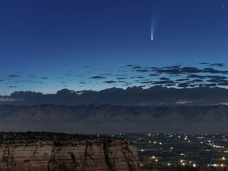 Comet streaking past Earth, providing spectacular show