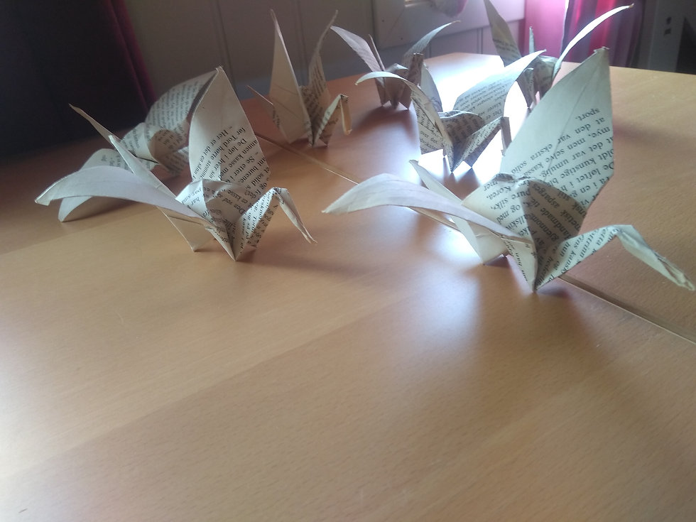 Recycled origami cranes