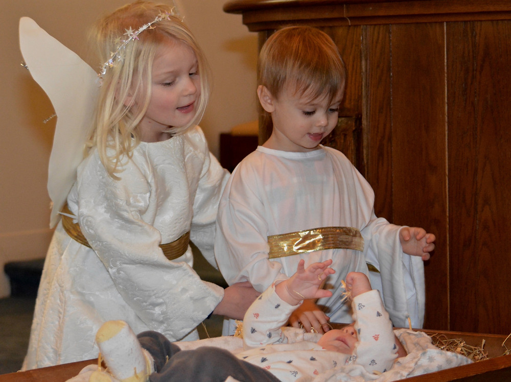 Angels adoring the Baby Jesus at a past Pageant.