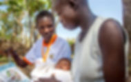 CHW provides health education to a mothe