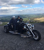Happy customers of Beacons Trike Tours at the top of he Black Mountain Pass in the Brecon Beacons
