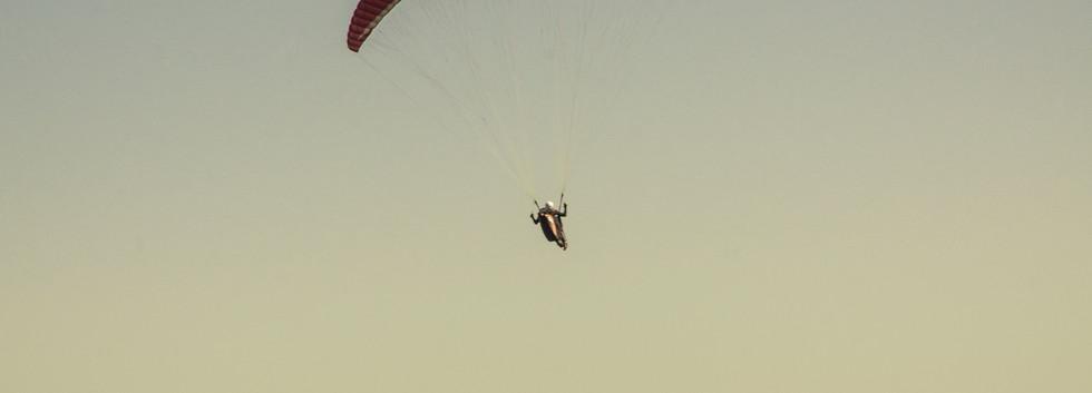 person-in-parachute-gliding-above-mounta