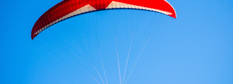 person-using-red-parachute-on-mid-air-16