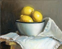 Three lemons in White Bowl