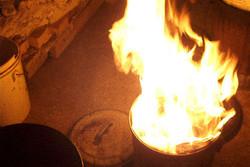 Flaming Raku can