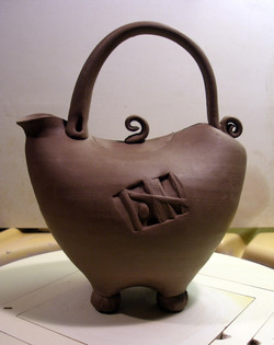 Teapot, leather hard stage.