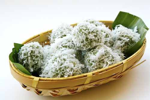 Ondeh-Ondeh or Klepon/kelepon is green coloured rice cake filled with palm sugar and rolled in grated coconut