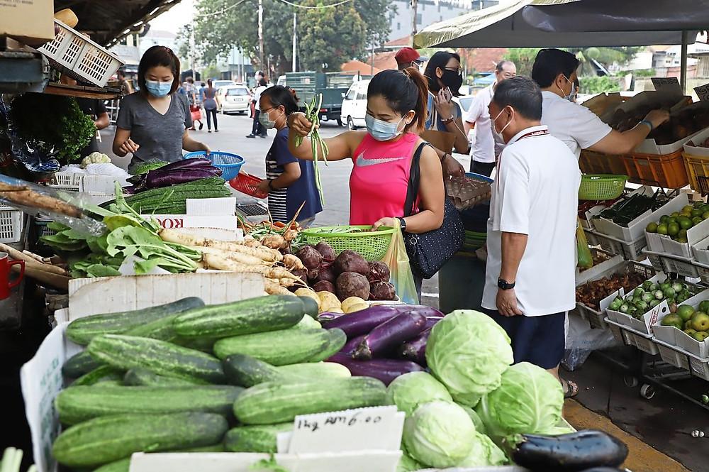 A local marketgoers somewhere in Myanmar. Photo Courtesy: Lim Beng Tatt   The Star(Myanmar)