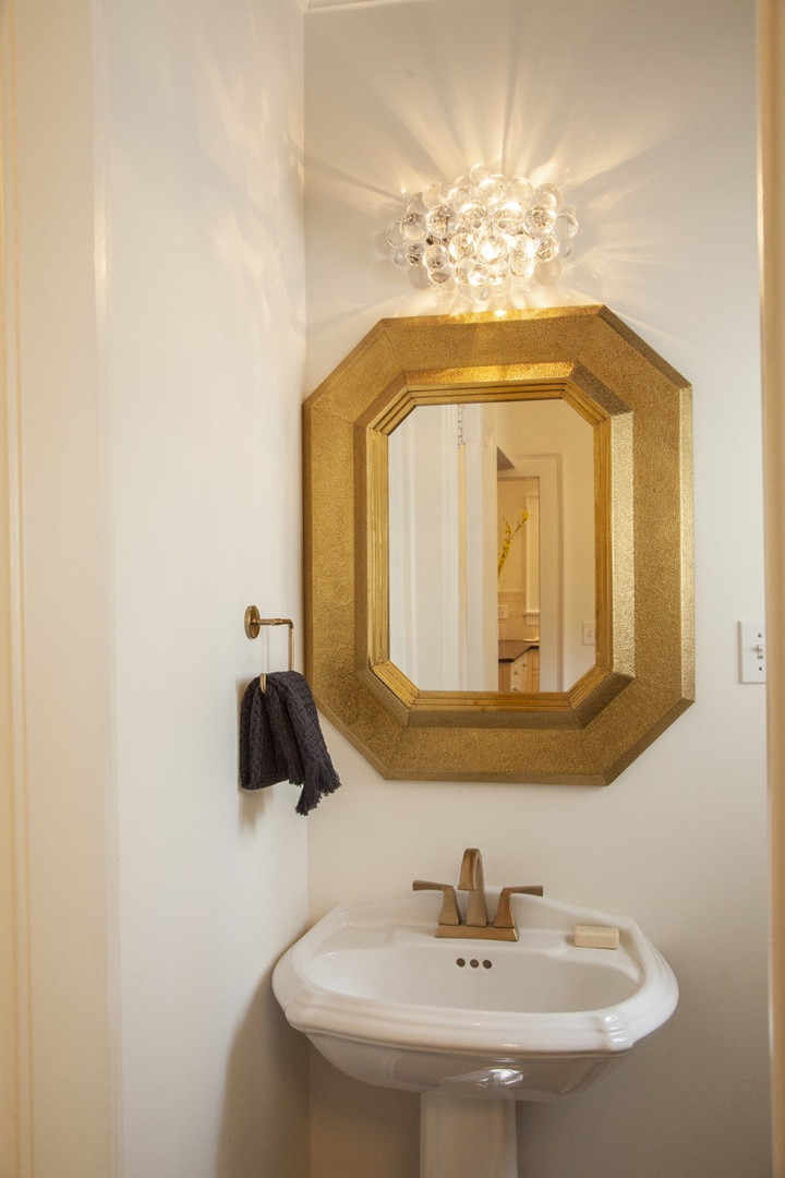 The home's glamorous touches continue into one of the four-and-a-half bathrooms.