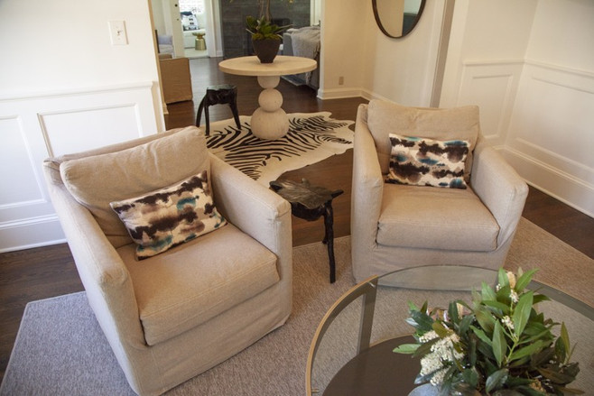 Renovations to the Tudor-style home turned a dining room into a casual lounge, or salon, now outfitted with chairs from Beau Interiors and open to the entryway.
