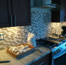 homeowner provided gorgeous glass and marble tile for us to Install