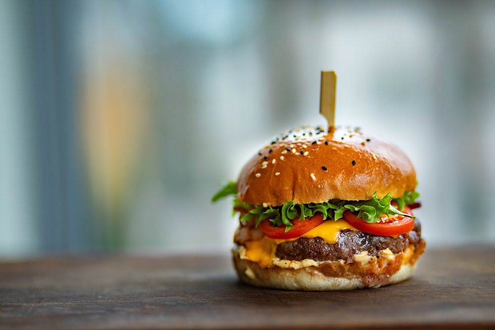 photo-of-juicy-burger-on-wooden-surface-