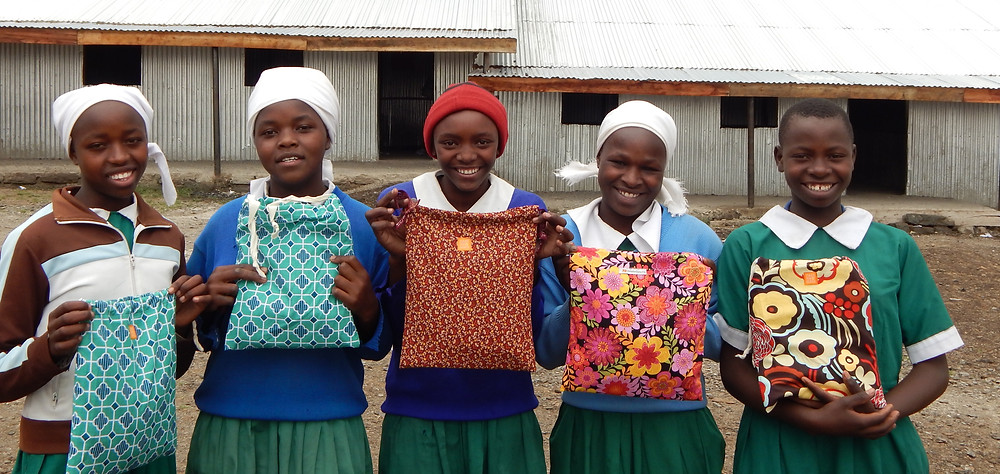 Girls at Shalom Primary with their sanitary packs