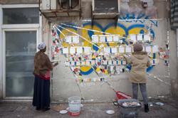 Mosaic in progress refugee women