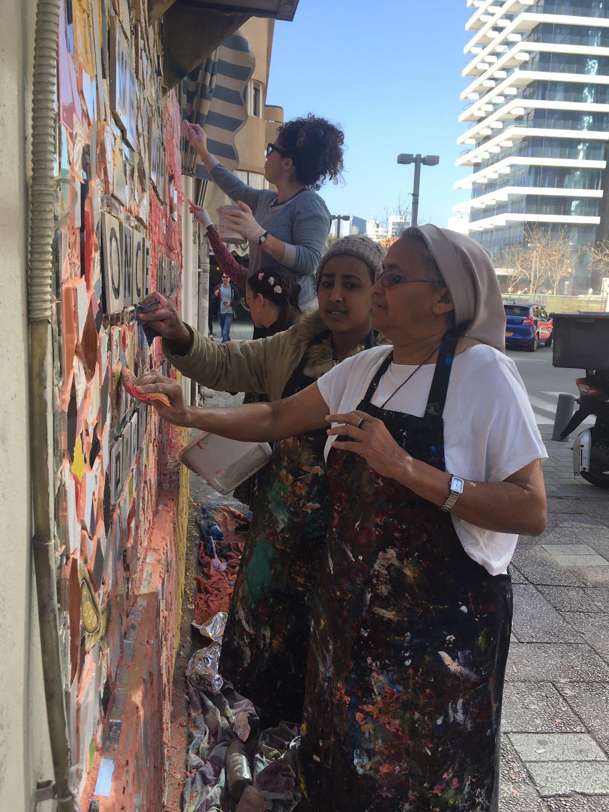 Mosaic refugee African women Israel