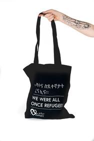 תיק בד כולנו היינו פליטים 20 שקל שחור. J