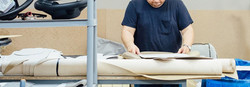 Upholsterer cutting fabric