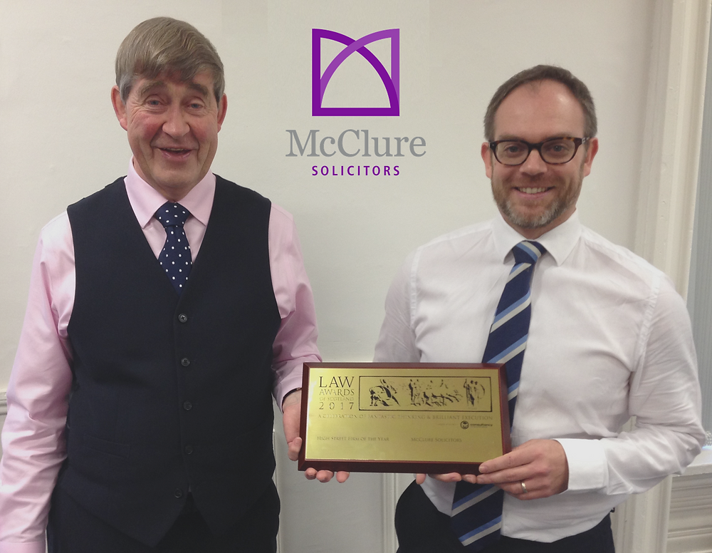 McClure Managing Director : Andrew Robertson and Director Stewart Moore with the High Street Firm of the Year Award 2017!