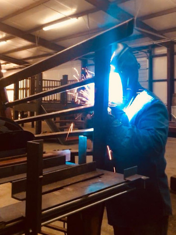 Welding railings on a staircase