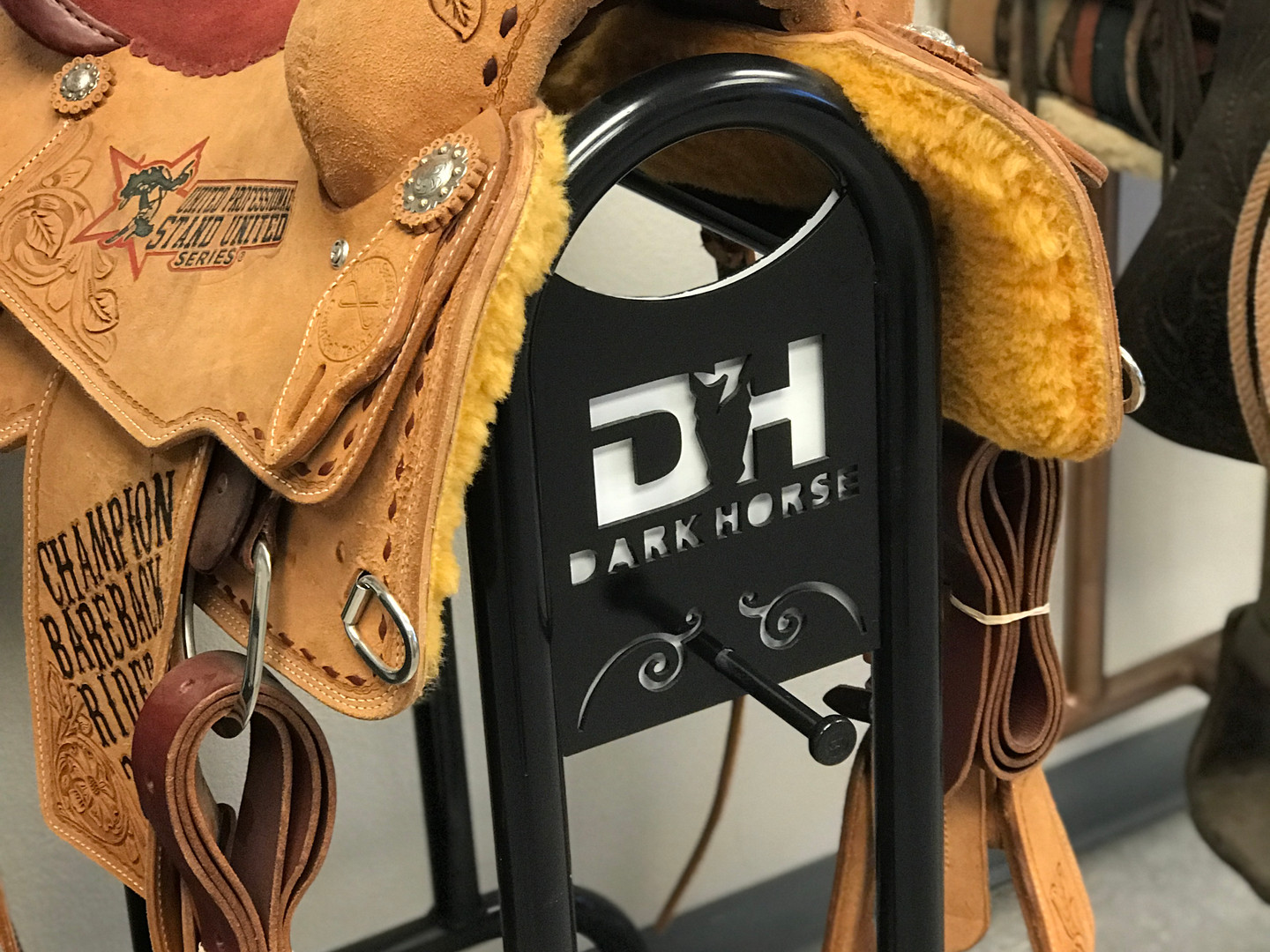 Saddle rack with personal brand
